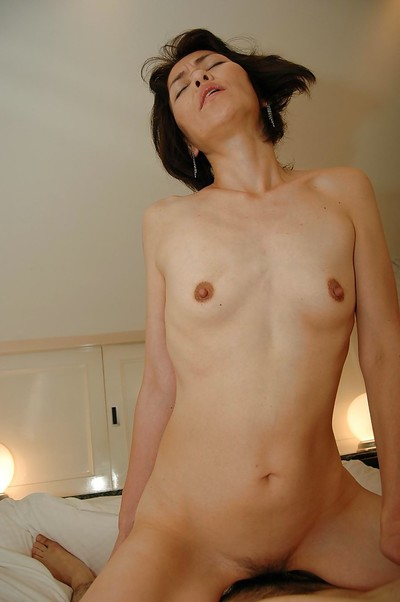 Slippy eastern MILF with diminutive melons receives her bushy bawdy cleft nailed and creampied