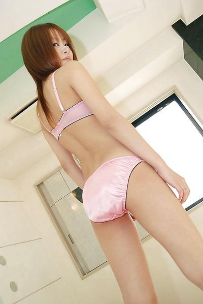 Tiny oriental infant Madoka Hamanaka undressing and swelling her legs