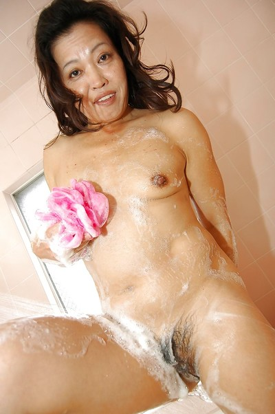 Dirty eastern MILF voluptuous shower-room and rubbing her soapy apples