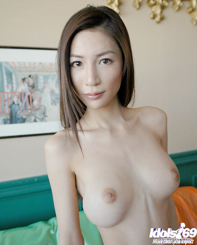 Bare Japanese amateur angel showcasing her tiny scones and  slit