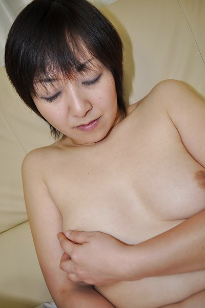 Obese Japanese MILF Masae Shimatani undressing and playing with she is