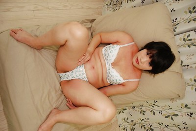 Japanese lady Akiko Kano undressing and exposing her trimmed gash in close up