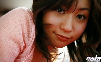 Stunning oriental cutie Momo Yoshizawa exposing her thin stoops on the mattress