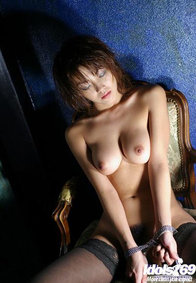 Delightful Chinese cutie in ebony nylon nylons posing manacled