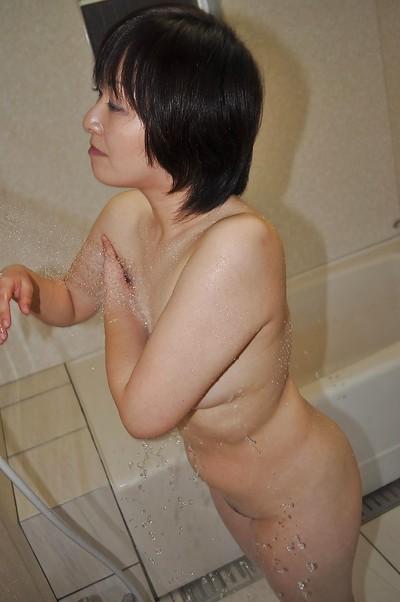 Eastern MILF with ample wazoo and furry gash Masae Shimatani entrancing bath
