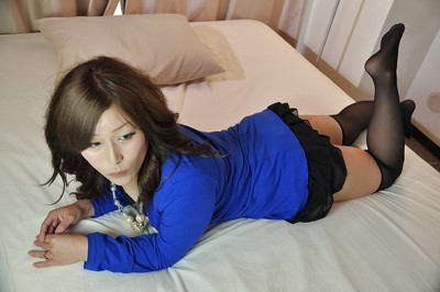 Seductive oriental MILF Tomoka Kuroki getting as mother gave birth and playing with a fake penis
