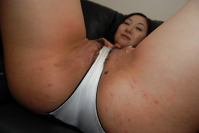 Sassy oriental MILF Risa Okamoto getting bare and stretching her legs