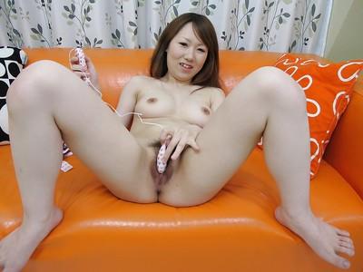 Chinese infant Maya Araki undressing and enthralling her hirsute vagina with sextoys
