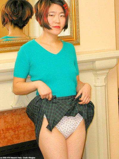 Juvenile Oriental in OTK  sheds underwear to unveil bushy muff