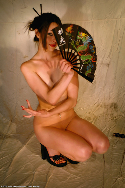 Youthful Oriental pretty in high heels and suit bares little front bumpers and penetrated nips