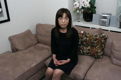 Dressed dear Kazue Hamano is revealing her Japanese shaggy snatch in close up