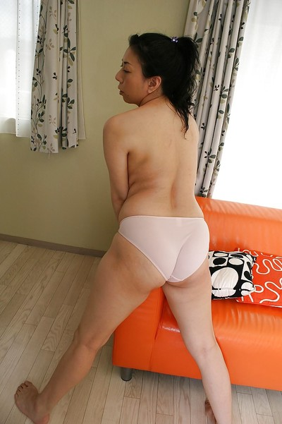 Saucy Japanese MILF Kumiko Yasue positions in underclothes and divulges her shapely love bubbles