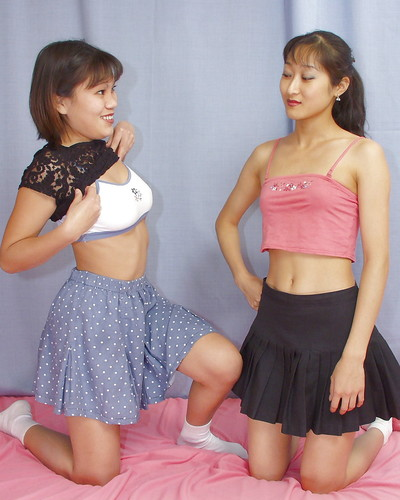 Lecherous Chinese lassies have some striptease and girl-on-girl humping pleasure