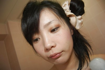 Smiley Japanese adolescent with heavy tit buttons enchanting shower-room and caressing she