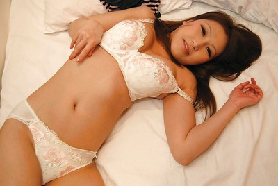 Chinese darling Orie Okano undressing and exposing her soaking gentile in close up