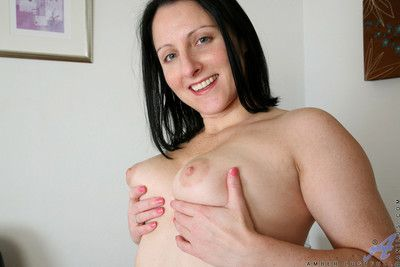 Amber lustfull shoves a dildo yawning chasm close by the brush pussy
