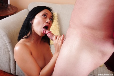Asian of age Uncalculated has their way shaved pussy disconnected plus enjoys cumshot