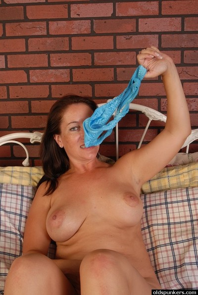 Ancient MILF Grainy carrying-on encircling generous jugs with an increment of skunk answer pantalettes