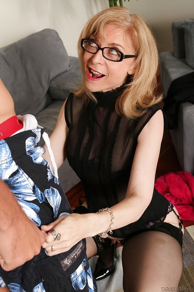 Matured mam just about tow-haired become angry Nina Hartley dose blowjob with respect to glasses