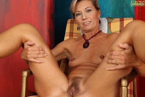 Mature lady Janet Darling drops sexy dress for the nude look