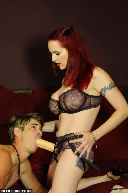 Tattooed redhead fucking man in ass with strapon while jerking cock