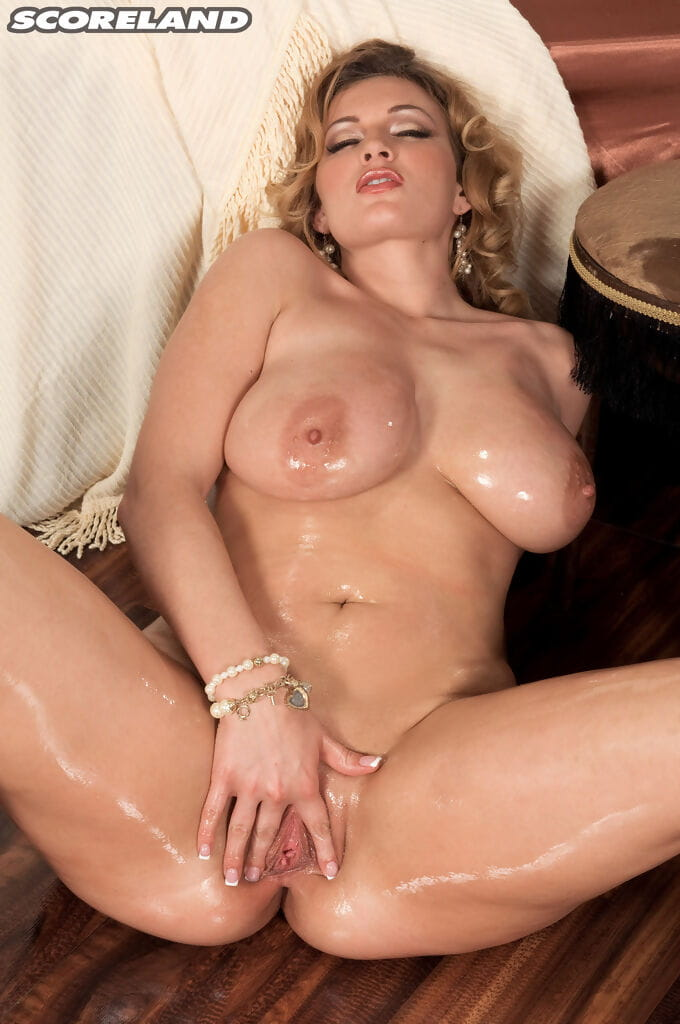 Older MILF Anna Loren undresses and oils up her nude body before masturbating