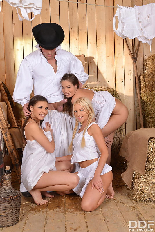Hot girls take on a big cock during a reverse gangbang in period costumes