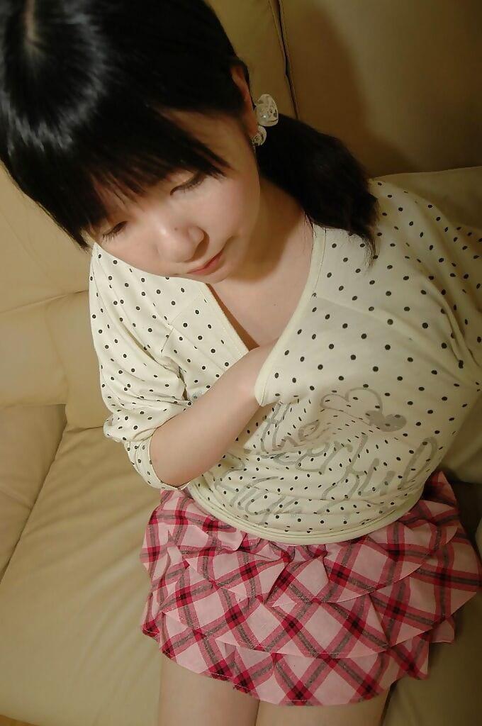 Asian teen in knee socks taking off her panties and exposing her shaved gash