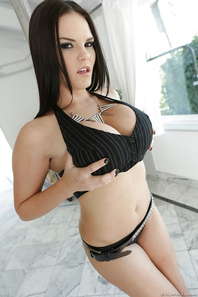 Tempting raven-haired pornstar undressing and exposing her big boobs