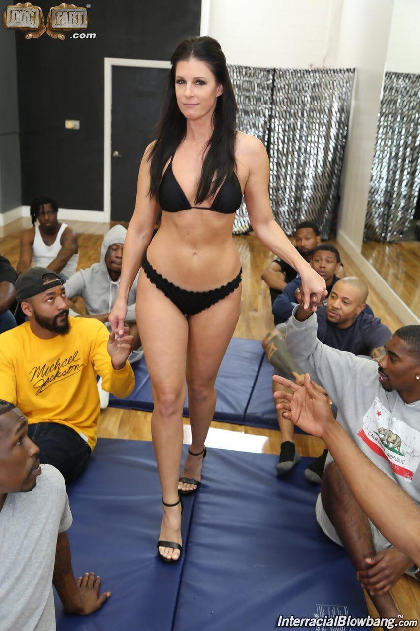 Brunette slut loses her bikini during a hardcore interracial gangbang