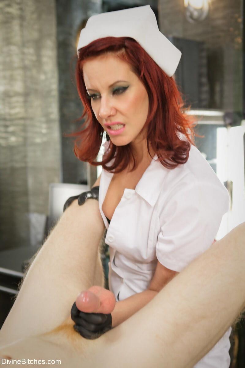 Redhead nurse Maitresse Madeline Marlowe uses BDSM tools on a shackled patient