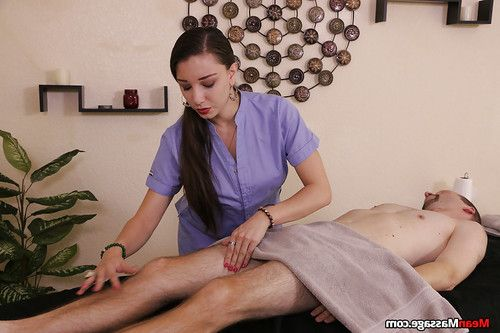 Brunette masseuse administering cock and ball torture on restrained man