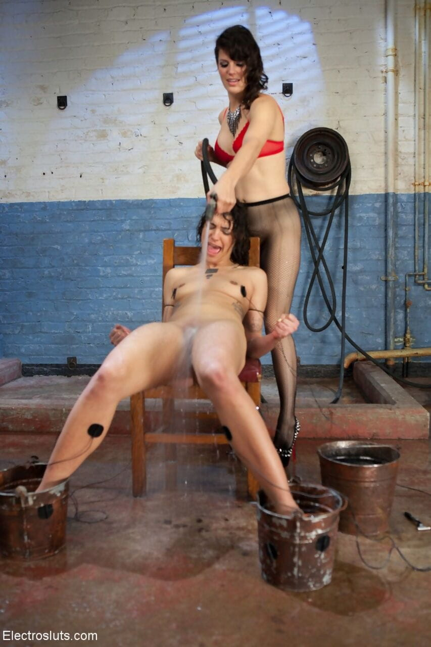 Skinny slave Bianca Stone fixed with electrodes & spread for hairy pussy shave
