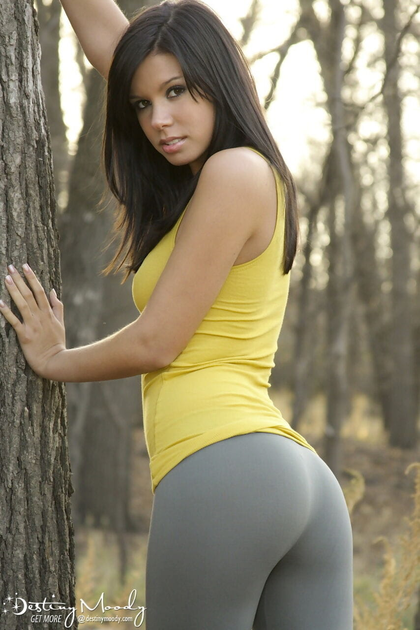Amateur model Destiny Moody tales off her spandex pants in the woods