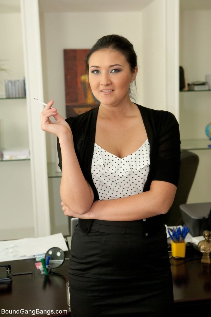 Naughty secretary Vanessa puts out a cigarette and strips in the office