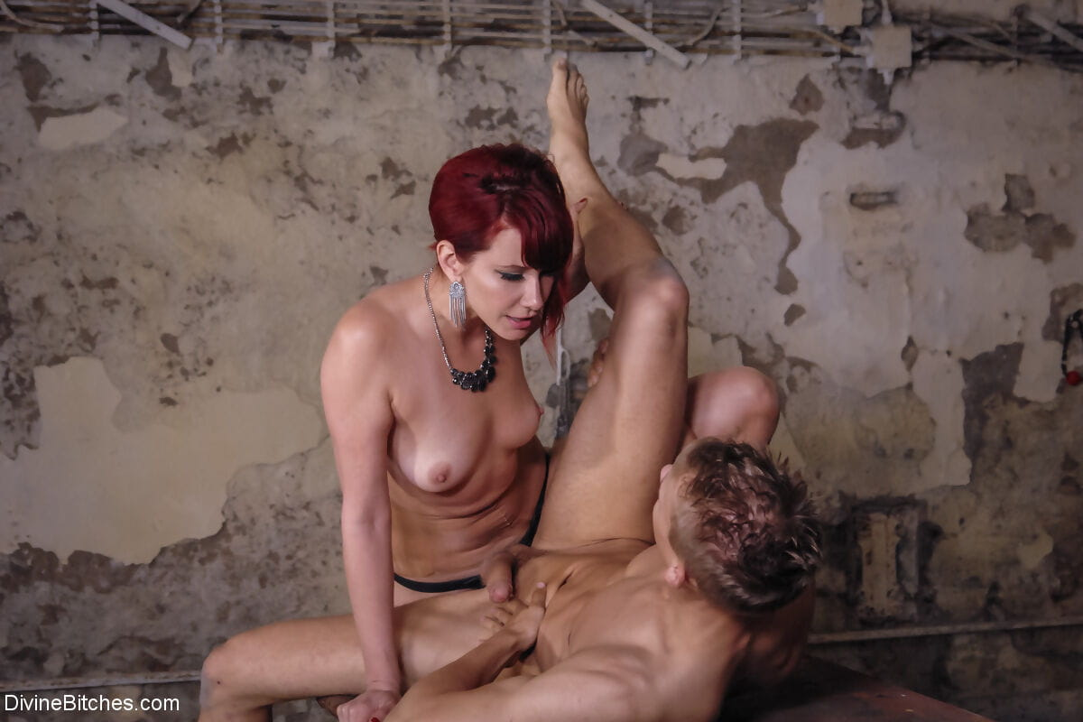 Hot domme Maitresse Madeline Marlowe slowly slides a toy in a young guys ass