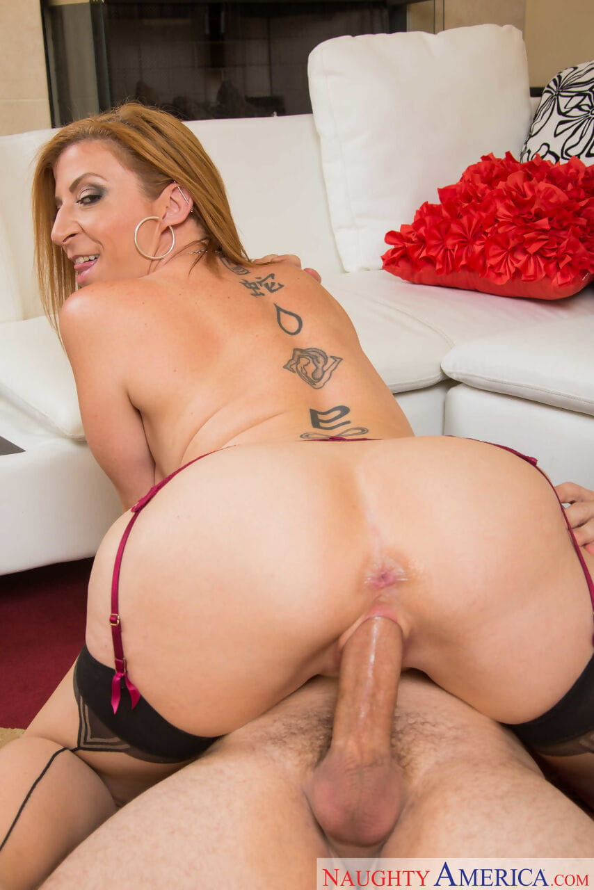 Horny cougar Sara Jay seduces a younger man in nylons and lingerie