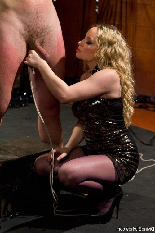 Kinky dominatrix tied up and strap-on fucked slave guy