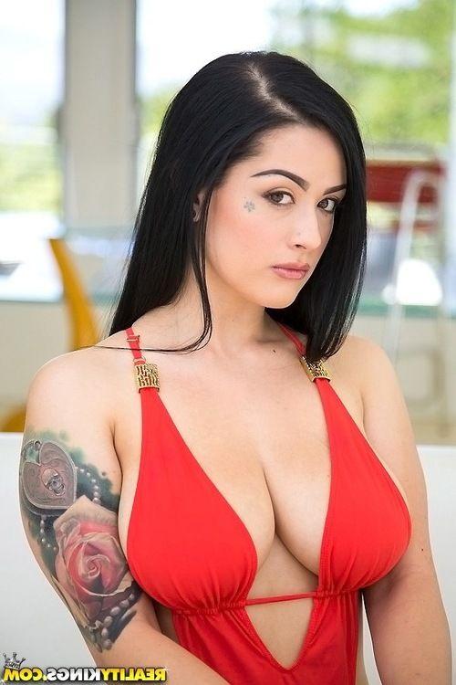 Bikini model with big tits Katrina Jade is showing her sexy tattoos