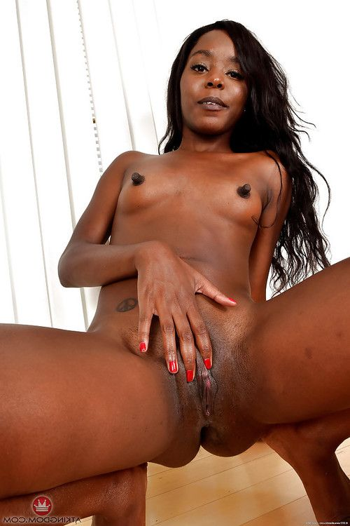 Black babe exposing long nipples before spreading shaved pussy
