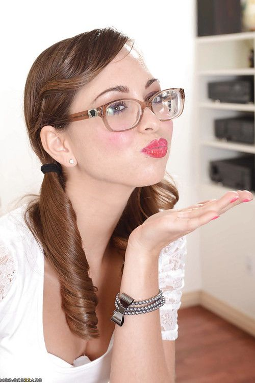 Brunette teenage cutie in glasses Riley Reid slipping off her clothes