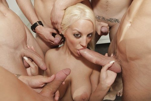 Nasty chick Blonde Fesser sucks off many large cocks while taking anal