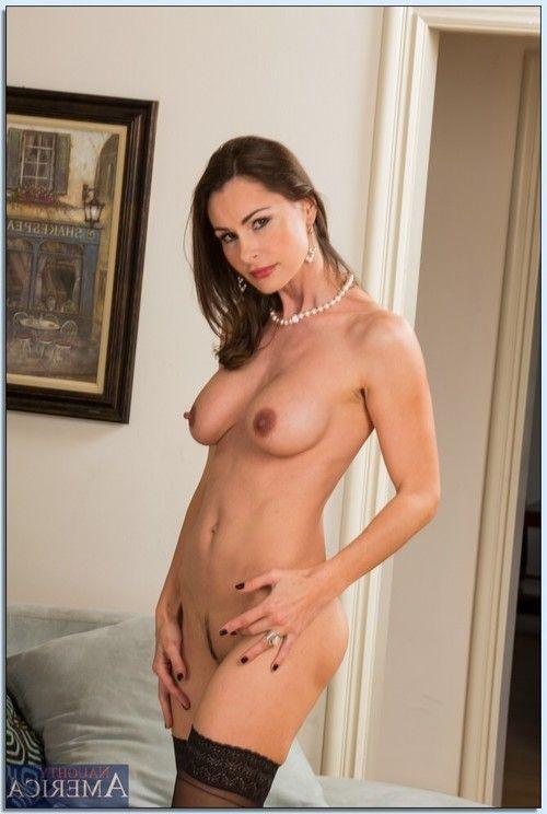 Mature vixen Nora Noir slipping off her dress and erotic lingerie