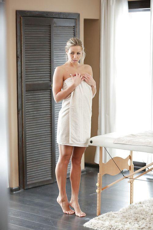 Blonde babe Christen Courtney exposing phat thong clad ass before massage