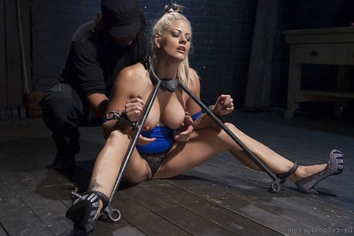 Hot blonde MILF Holly Heart taking painful electroshock on thighs and tits