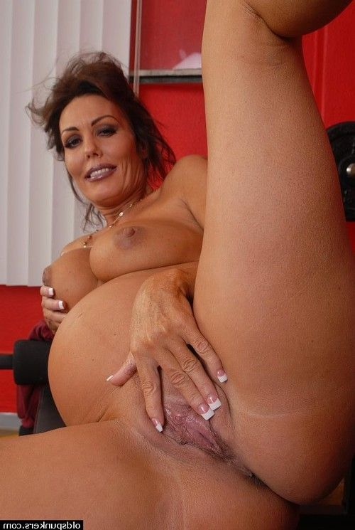 Older pregnant woman Nancy exposing belly bump and masturbating spread cunt