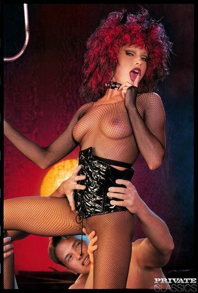 Big boobed redheaded nympho clad in her leather gear and fishnet