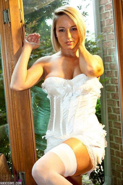 Amateur MILF Nikki Sims teasing in frilly lingerie and white stockings