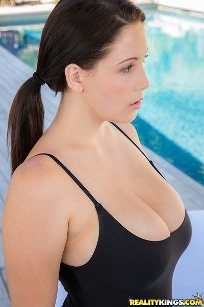 Tempting brunette babe in swimsuit revealing her gorgeous massive jugs