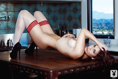 Firm titted mature Asian centerfold Teresa Ransom poses in stockings and heels